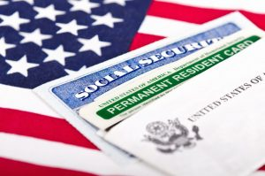 BLOG-PHOTO-GREEN-CARD-ON-FLAG-copy-300x199